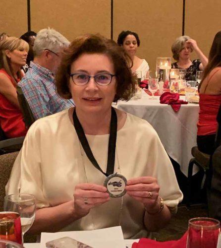 Carmen with award