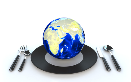 globe on a plate with flatware